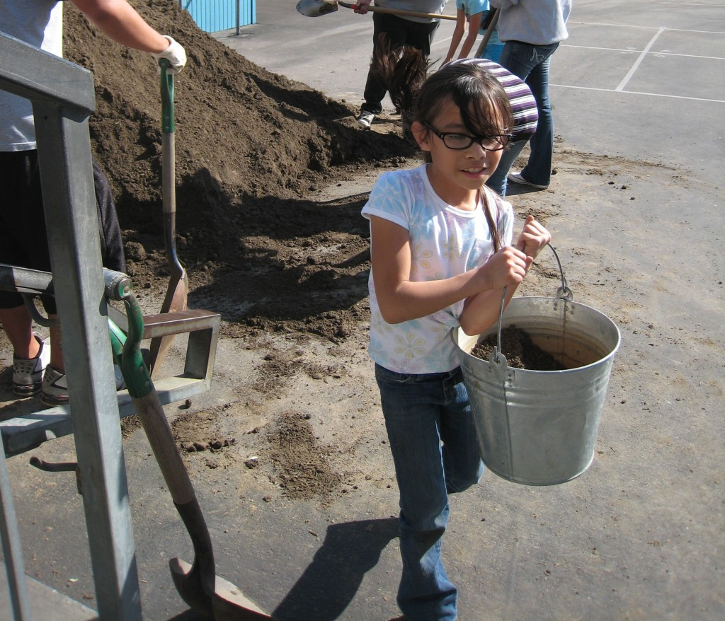 Moving soil for the edible garden beds at First Street School in Los Angeles (an LA's Best School).